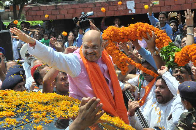 Amit Shah arrives to grand welcome in city