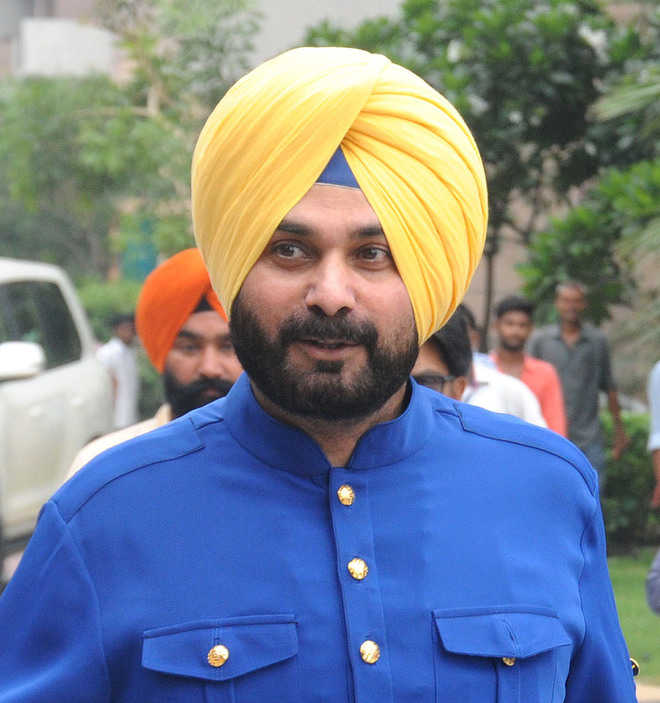 Probe illegal buildings in city: Sidhu to SDM