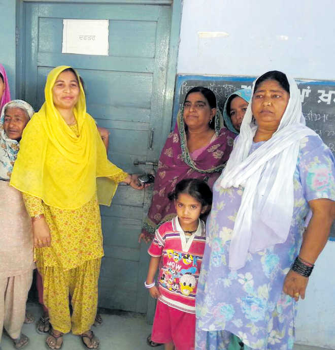 Villagers stand up for principal, lock school