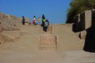 In this photograph taken on February 9, 2017, visitors walk through the UNESCO World Heritage archeological site of Mohenjo Daro some 425 kms north of the Pakistani city of Karachi. AFP