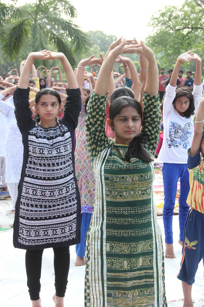 Students, residents come together to celebrate Int'l Yoga Day