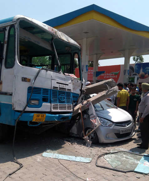 2 injured as bus hits electricity pole