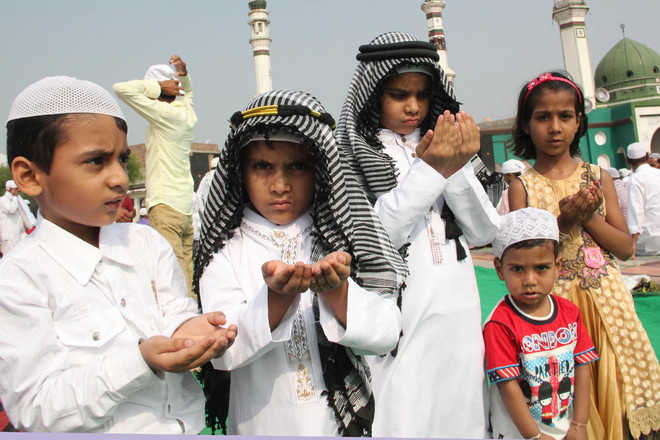 Prayers, sweets, exchange of gifts mark Eid celebrations