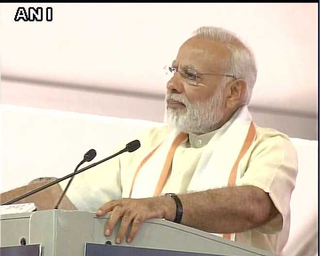 Killing people in the name of cows unacceptable: Modi