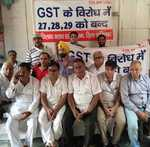 Traders protest, govt says GST-ready