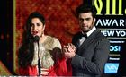 Bollywood actress Katrina Kaif (L) speaks as actor Manish Paul holds her hand during IIFA Rocks, part of the 18th International Indian Film Academy (IIFA) Festival, on early July 15, 2017, at the MetLife Stadium in East Rutherford, New Jersey. AFP photo