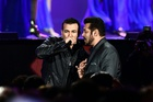 Bollywood singer Kamal Khan and actor Salman Khan (R) perform during IIFA Rocks July 14, 2017 at the MetLife Stadium in East Rutherford, New Jersey during the 18th International Indian Film Academy (IIFA) Festival. AFP photo