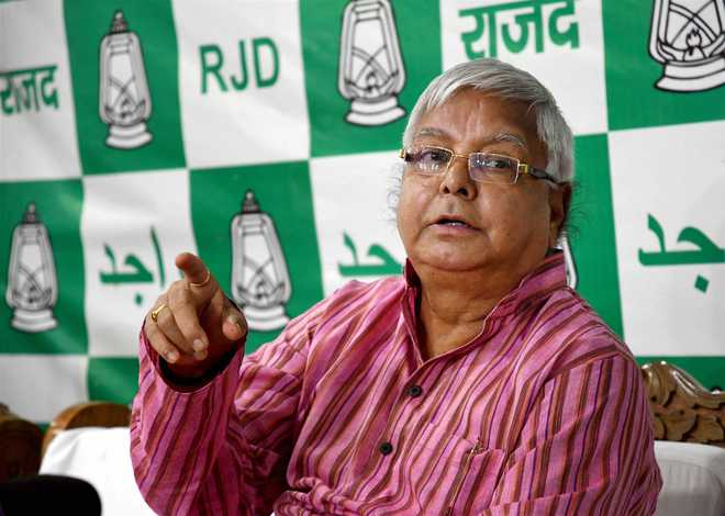 Lalu hits back, terms Nitish 'political turncoat'