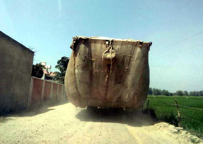 Overloaded tractor-trailers a traffic hazard on city roads