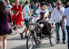 A participant in the 5th Lady on Bicycle annual festival rides her tricycle in the Sokolniki park in Moscow on August 6, 2017. AFP