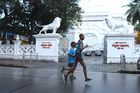 Indian runner Samir Singh (L) runs in Mumbai. AFP