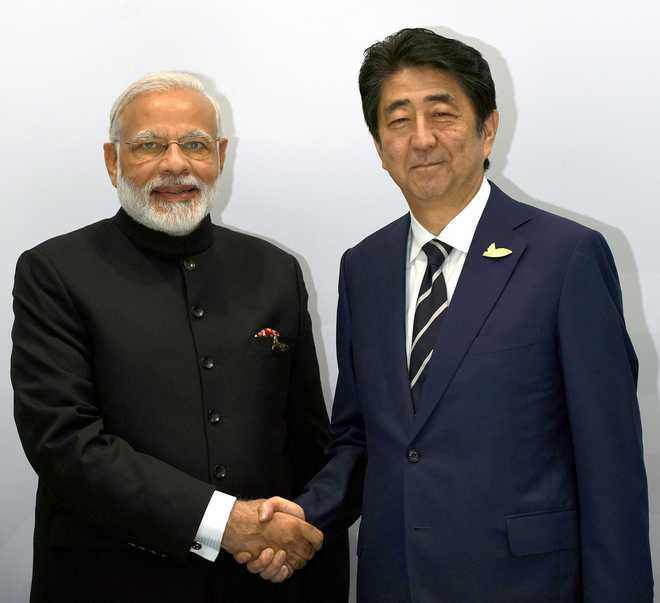 Japanese PM Abe arrives on two-day India visit