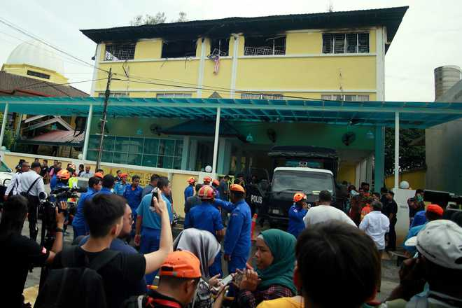Boys 'cried from barred windows' as school blaze kills 23 in Malaysia