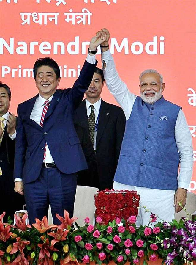 India, Japan sign 15 agreements after bilateral summit between Modi, Abe