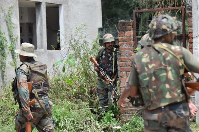 2 security men among 4 injured in grenade attack in Kashmir's Sopore