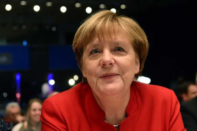 Germany votes as history beckons for Merkel, and far-right