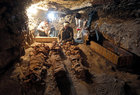 Egyptian antiquities workers preserve mummies in the recently discovered tomb of Amenemhat, near the Nile city of Luxor, south of Cairo, Egypt, September 9. Reuters