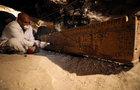 Egyptian antiquities worker brushes a coffin in a recently discovered tomb of Amenemhat, a goldsmith from the New Kingdom near the Nile city of Luxor, south of Cairo, Egypt, September 9. Reuters