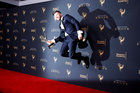 Choreographer Travis Wall jumps as he poses with his Outstanding Choreography Emmy Award for 'So You Think You Can Dance' backstage at the Creative Arts Emmy Awards in Los Angeles. September 9. Reuters