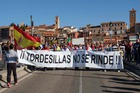 People hold a banner reading 'Tordesillas does not surrender' during a demonstration to support bullfighting before the Toro de la Pena festival, formerly known as Toro de la Vega in the central Spanish town of Tordesillas, on September 12. AFP