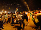 People dance during the New Year's celebrations on a beach in Mumbai on January 1, 2018. Reuters photo