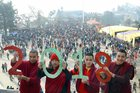 Monks hold cut outs of 2018 to welcome the New Year at the Ridge in Shimla on December 31, 2017. PTI photo