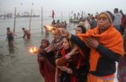 Devotees offer prayers after taking a holy dip in Ganges river during Magh Mela festival at Sangam in Allahabad on January 2. PTI