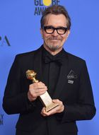 Actor Gary Oldman poses with the trophy for Best Performance by an Actor in a Motion Picture-Drama during the 75th Golden Globe Awards on January 7, 2018, in Beverly Hills, California. AFP photo