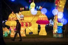 Visitors look at giant lanterns installed in the Foucaud Park in Gaillac, southwestern France, on the occasion of the Lantern Festival, on January 8, 2018. Thirty-six paintings and nearly five hundred monumental silk sculptures are exhibited in Gaillac from December 1, 2017 to January 31, 2018. In China the traditional Lantern Festival marks the end of celebrations for the Chinese Lunar New Year period. AFP photo