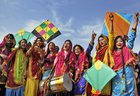 Women, dressed in their traditional Punjabi attire, fly kites as they celebrate the festival of Lohri in Amritsar on January 12. PTI