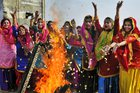 College students, wearing traditional Punjabi dresses, dance during the Lohri festival celebrations in Amritsar on January 12. PTI