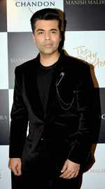 KJo 'excited' to hear PM Modi at WEF