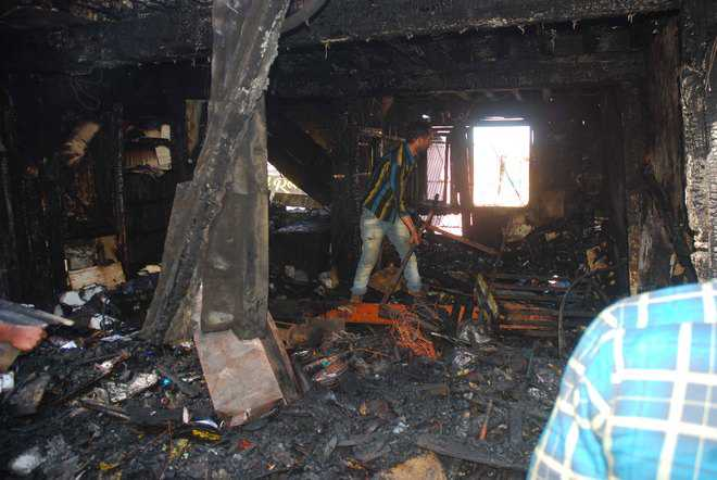 Seven shops, ATM reduced to ashes in Lakkar Bazaar