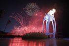 Fireworks explode behind the Olympic flame during the opening ceremony of the 2018 Winter Olympics in Pyeongchang, South Korea, February 9. AP