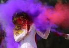 College girls throw coloured powder to one another during Holi festival celebrations in Bhopal on February 28. AFP