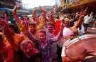Hindu devotees, smeared in coloured powder, dance as they take part in a procession for Holi celebrations in Kolkata, February 28. Reuters
