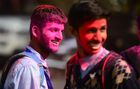 Youths play with coloured powder outside a school in Allahabad on February 28. AFP
