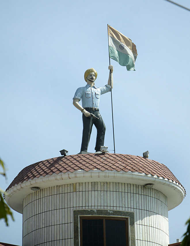Martyr's statues installed atop houses in his native village