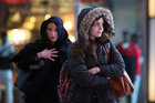 Women walk through the rain in Times Square in Manhattan in New York, US, March 7. Reuters
