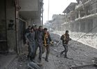 Volunteers from the Syrian civil defence help a man in Hamouria during Syrian government shelling on rebel-held areas in the Eastern Ghouta region on the outskirts of the capital Damascus on March 6, 2018. AFP photo