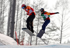 Daichi Oguri (R) of Japan and Chris Vos of the Netherlands compete in Men's Snowboard Cross SB-LL1 - Quarterfinal. Reuters