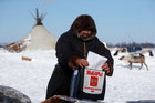 A herder of the agricultural cooperative organisation 'Harp' takes part in the early voting in remote areas ahead of the presidential election, at a reindeer camping ground, about 250 km south of Naryan-Mar, in Nenets Autonomous District, Russia, March 4. Reuters