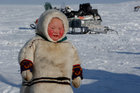 A child from the indigenous community 'Yamb To' (Long Lake) is seen at a reindeer camping ground, about 450 km northeast of Naryan-Mar, in Nenets Autonomous District, Russia, March 1. Reuters