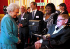 Britain's Queen Elizabeth (L) meets Stephen Hawking during a reception for Leonard Cheshire Disability charity at St James's Palace in London on May 29, 2014. Reuters