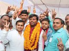 Samajwadi Party candidate Praveen Kumar Nishad flashes the victory sign after his success in the by-elections elections in Gorakhpur on March 14, 2018. PTI photo