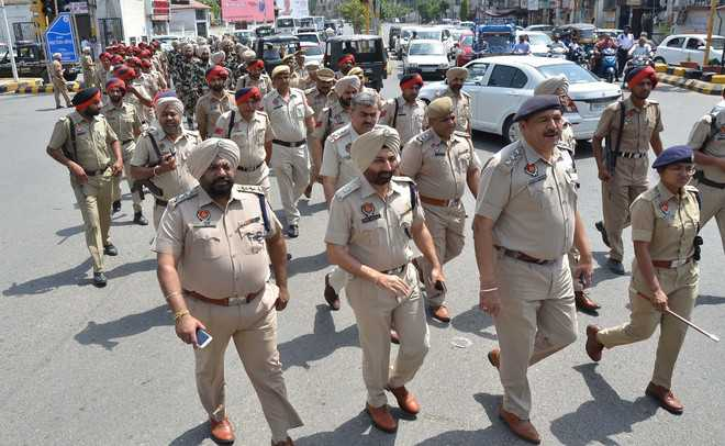 Flag march held to defuse tension