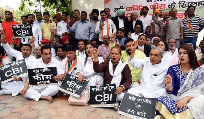 Cong protests parking fee hike, seeks rollback