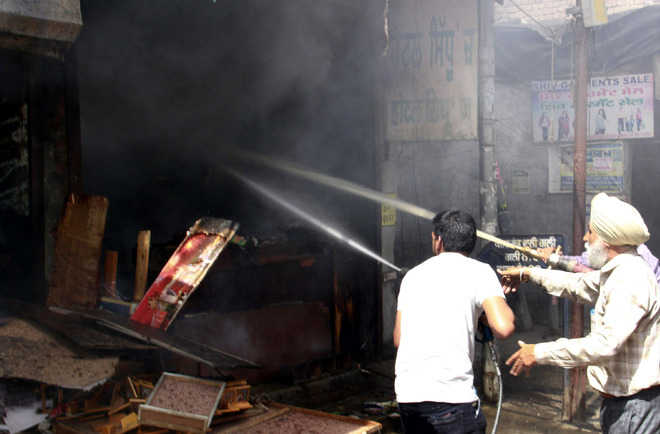 Goods worth lakhs gutted in 2 shops