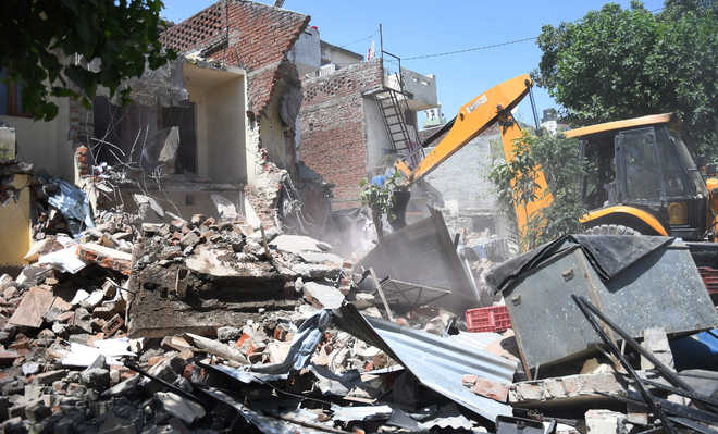 Illegal structures razed in Sec 29  amid protest