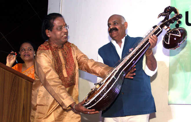 Guv launches musical instrument at art gallery